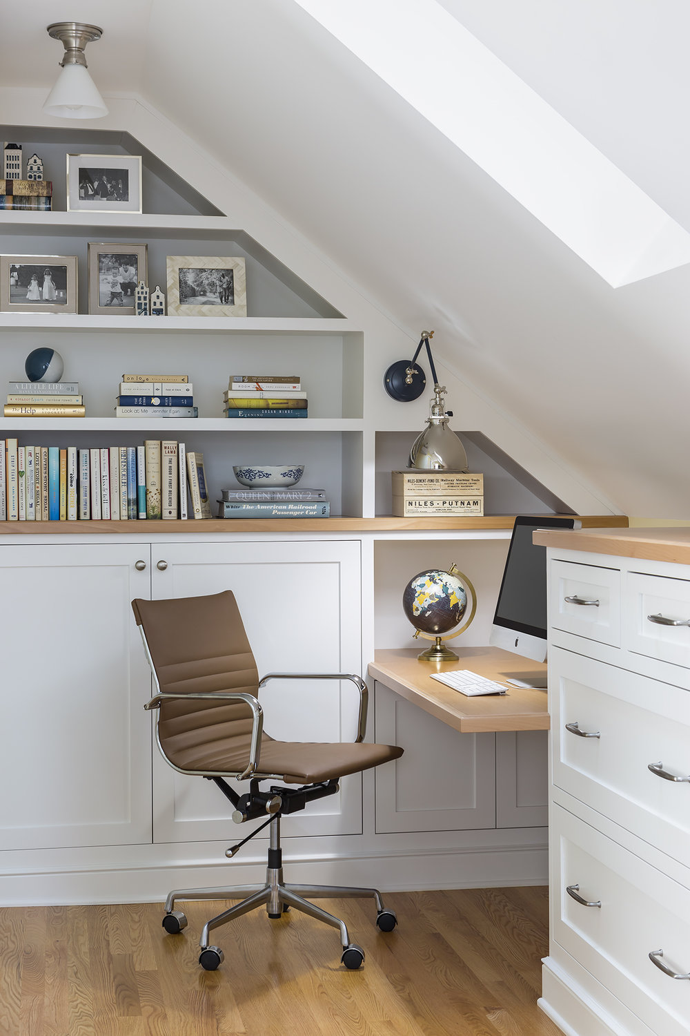 The homeowners wanted a small home office with lots of integrated storage opportunities.
