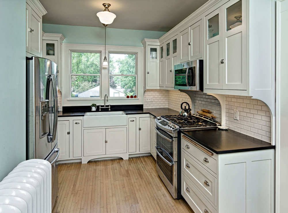 The homeowners wanted a classic black and white kitchen that fit with the age of their 1900s home but still offered modern conveniences.