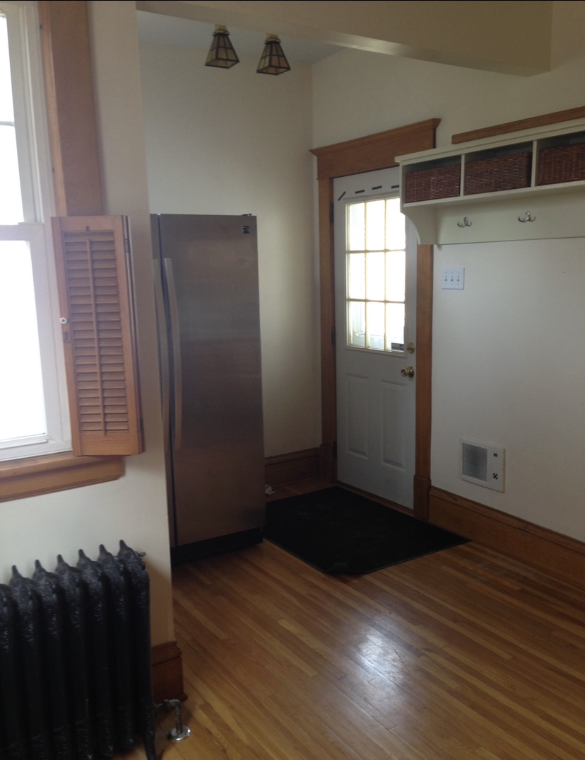 The original exterior door was relocated and the area just beyond this space was enclosed to accommodate the new mudroom.