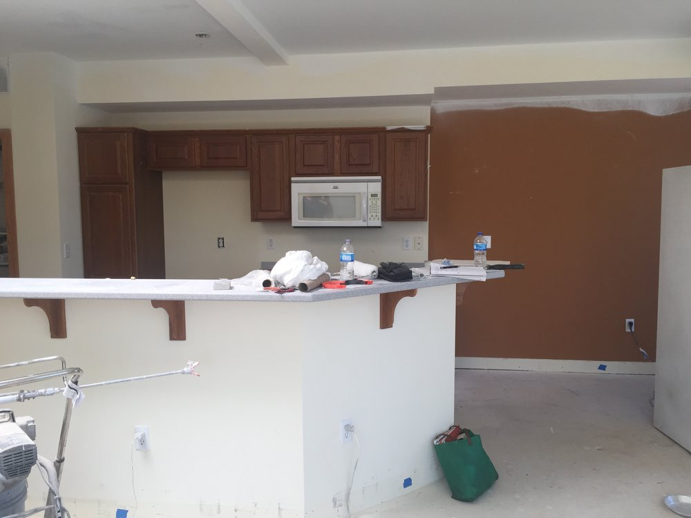 Prior to the renovation, the kitchen space felt dark and closed off from the rest of the condo.
