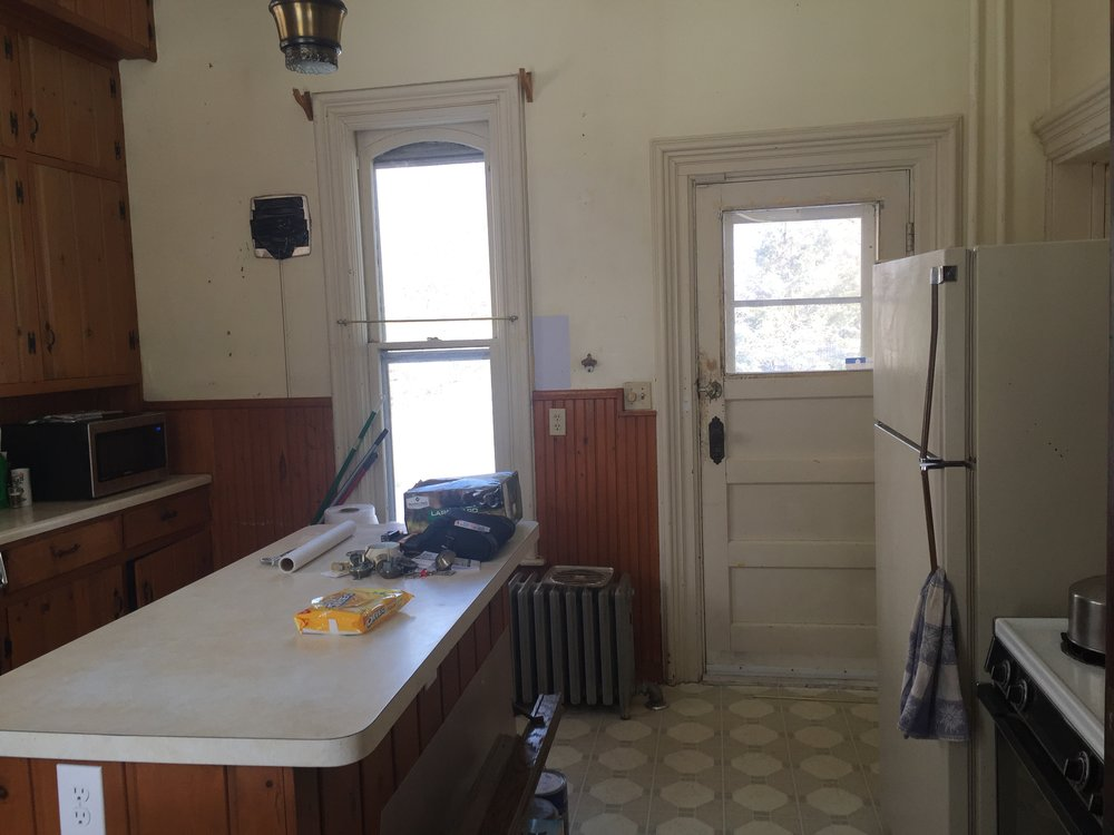 Some of the original features of the room, such as window and door location, remained the same.