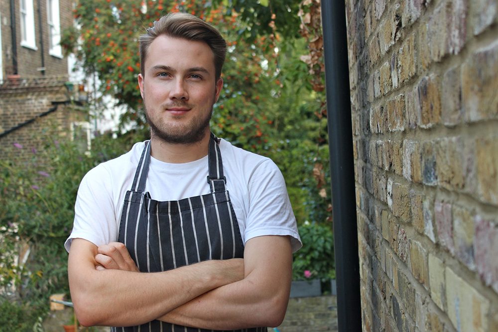 Tomos Parry Feast - Born and educated in Wales, Tomos trained at The River Cafe and Kitchen Table before running his own kitchen at Climpson's Arch in Hackney. Soon poached as head chef for the award winning Kitty Fishers in Mayfair, he went on to open his first restaurant Brat, in Shoreditch, in March 2018 to huge applause, the FT claiming it