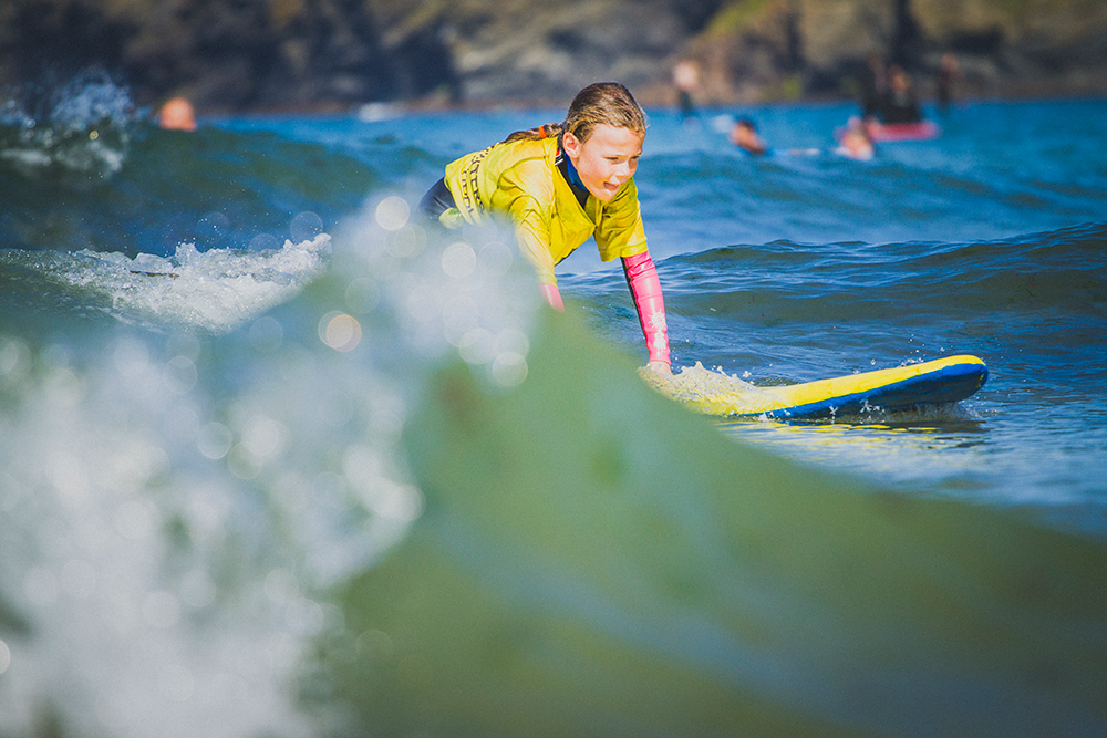 Kids Surf & SUPing - It's not just for the grown-ups you know! The Wavehunters surf school is situated on the beautiful Polzeath Beach, one of the safest and most reliable surf spots in Cornwall. We'll be running sessions for kids aged four and above over the weekend whether you're a total beginner or want to join Junior Groms Club having surfed before.Stand-up Paddle Boarding is also available for those aged four to twelve (accompanied by an adult of course) or those aged 13 to 18.