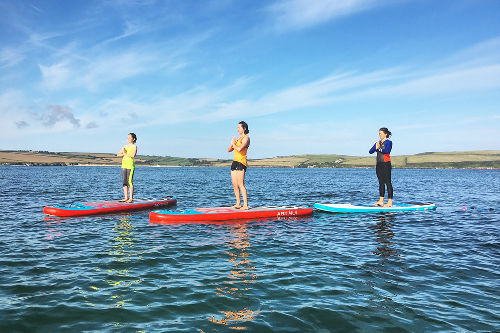 SUP Yoga & Fitness - Combining balance and fitness on a paddle board. Take your paddle boarding skills to a whole new level with this exciting collaboration of fitness and yoga. Enjoy the beautiful scenery of the Camel estuary from Daymer Bay, whilst challenging your balance, core strength, arm power and leg strength. SUP yoga fitness classes provide a mix of challenges and moves that will keep you more than entertained.
