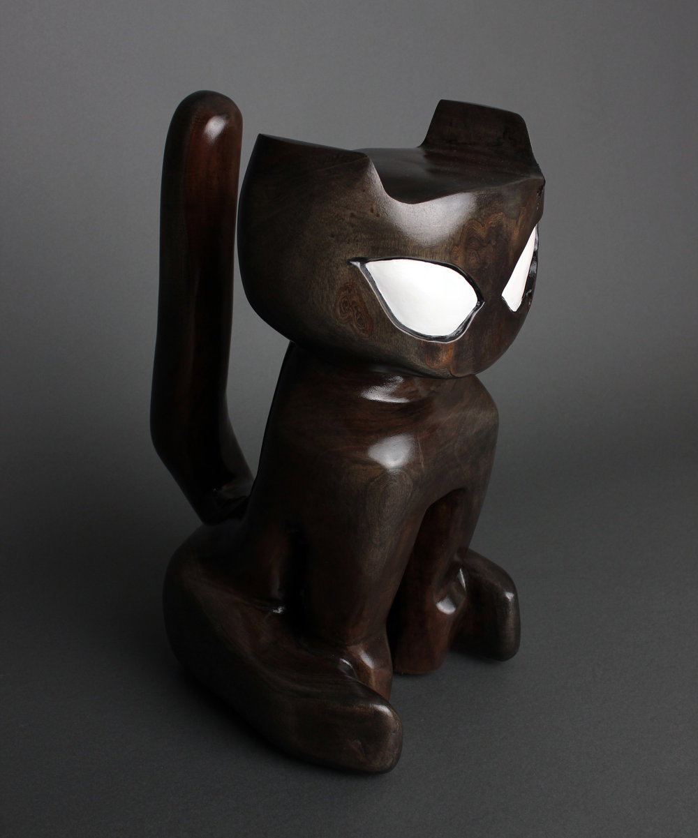 Cat Idol   reductive sculpture using a single block of mahogany harvested from my front yard. 2019 photo by   Alissa Deluca