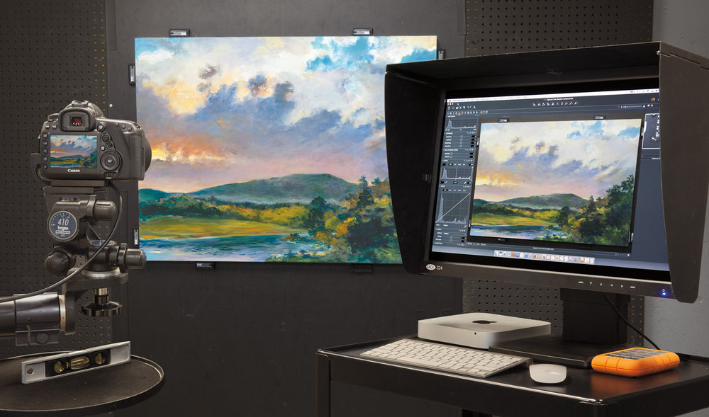 Camera, tethered to a computer, capturing Dorothy Fox's painting Sundown