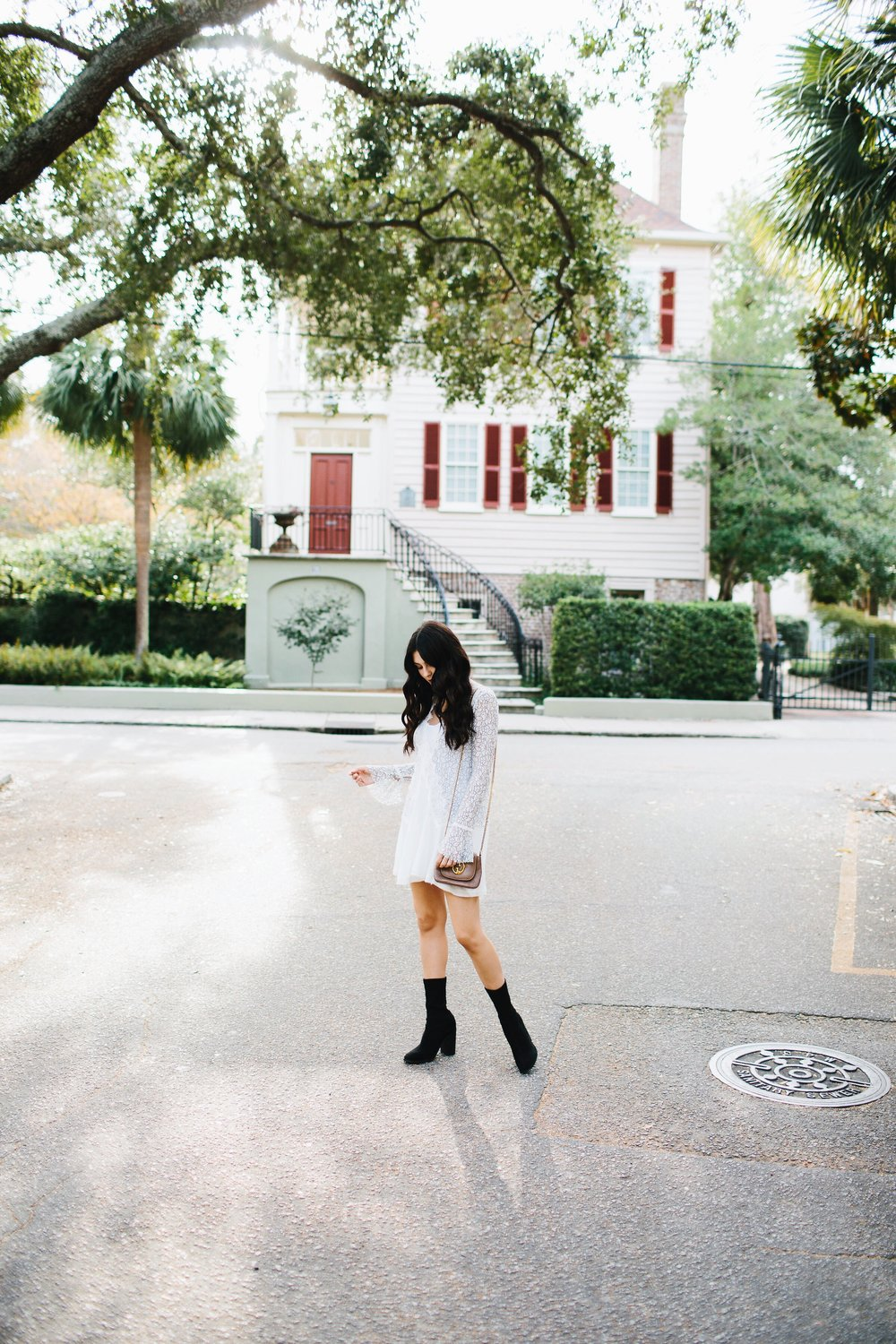 Julia Friedman wearing a Free People Lace Dress with suede boots from Nordstrom in Charleston, South Carolina.