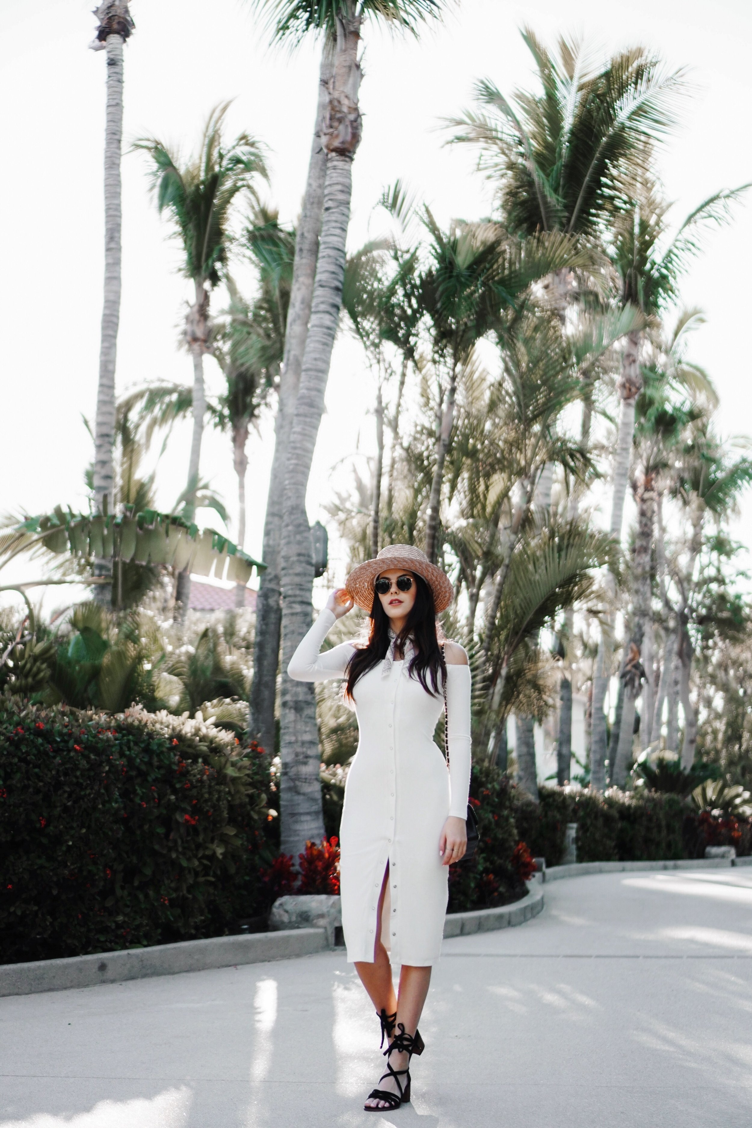 Julia Friedman wearing a Privacy Please dress from Revolve Clothing, Steve Madden shoes, and a Lack of Color hat at The One and Only Palmilla in Cabo.