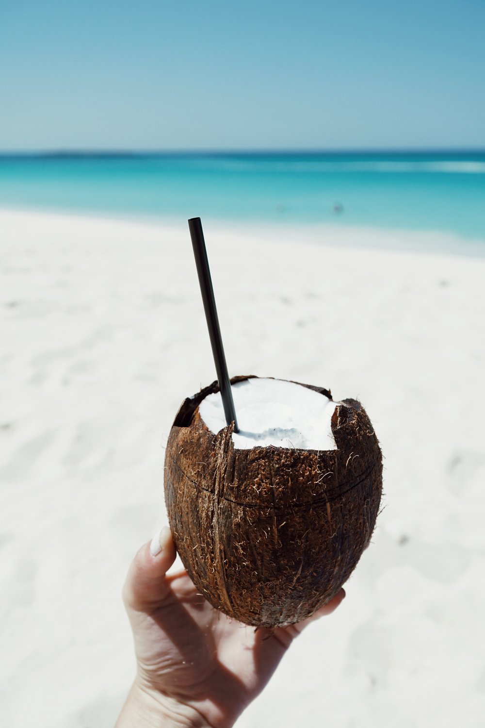 Julia Friedman enjoys a coconut smoothie at the One&Only Ocean Club in the Bahamas.