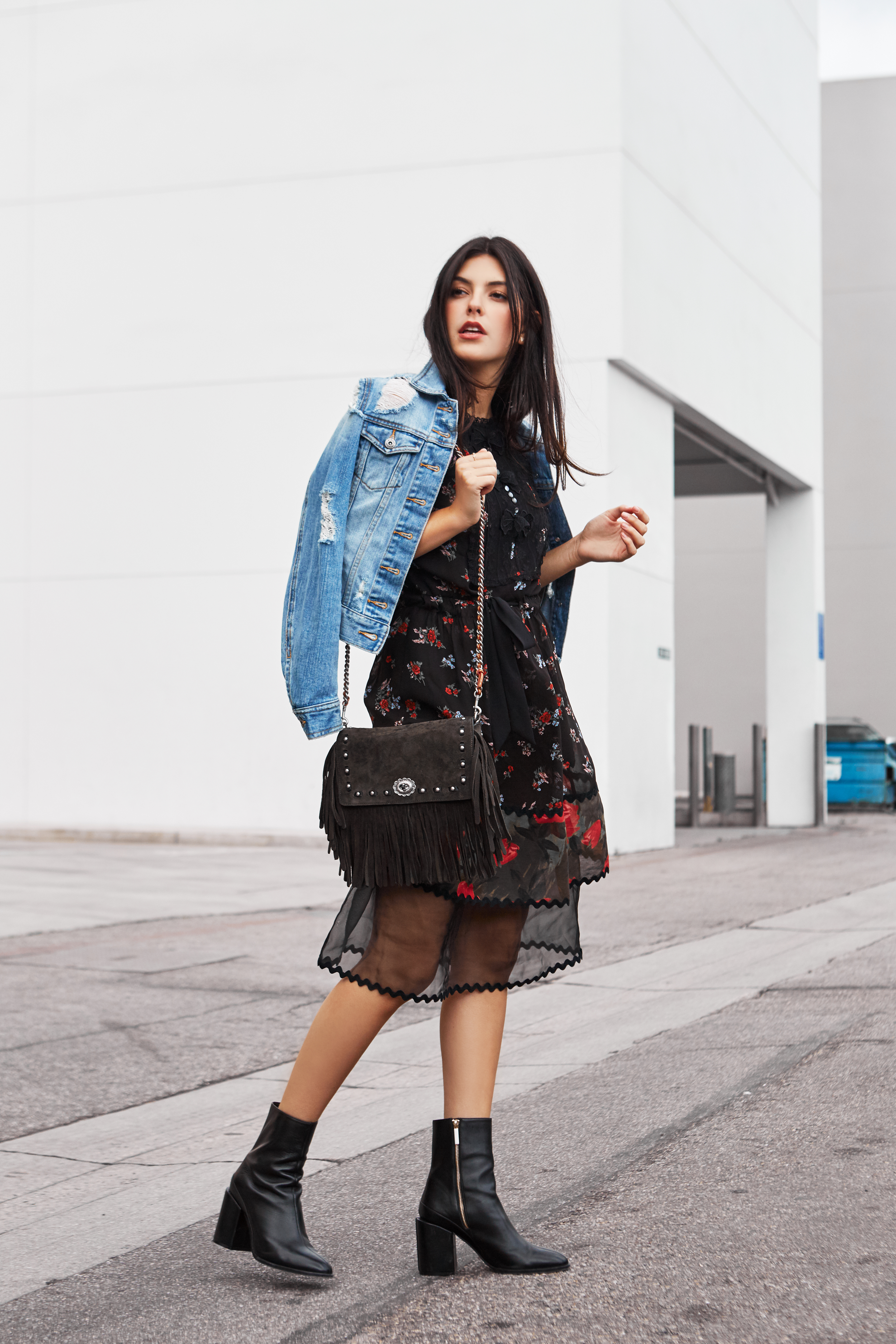 Julia Friedman makes florals look chic and edgy in Beverly Hills wearing a Coach Dress and Dear Francis boots.