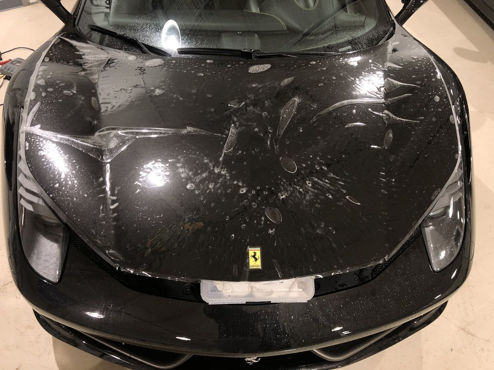 Ferrari 458 Hood with Film applied waiting to be installed.