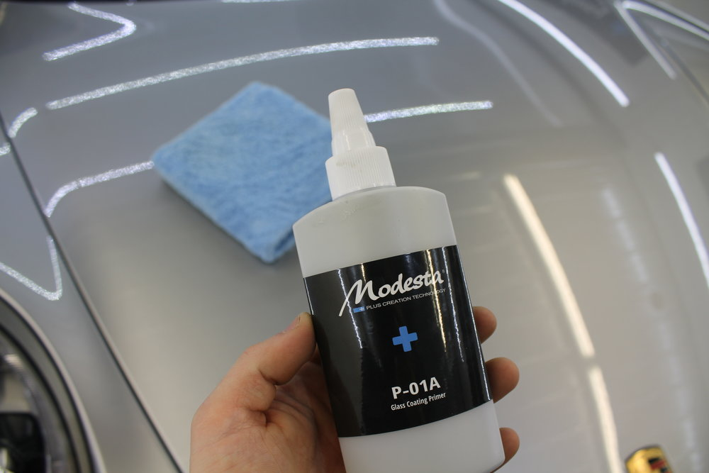SI02 Priming Process - Once the paint has been perfected, We install a thick, glossy primer that ensures a perfect long lasting bond with your vehicle's paintwork. This is only done once the paint is completely stripped of all polishing residue with 99% Iso-propyl alcohol. Modesta'sP-01A Primer is a highly advanced & unique primer used for Modesta liquid glass coatings. It contains a blend of high quality resins and additives capable of producing up to 10 microns on top of the paint. Once Applied, the paint is left to cure for 180 minutes before the coating process can begin.