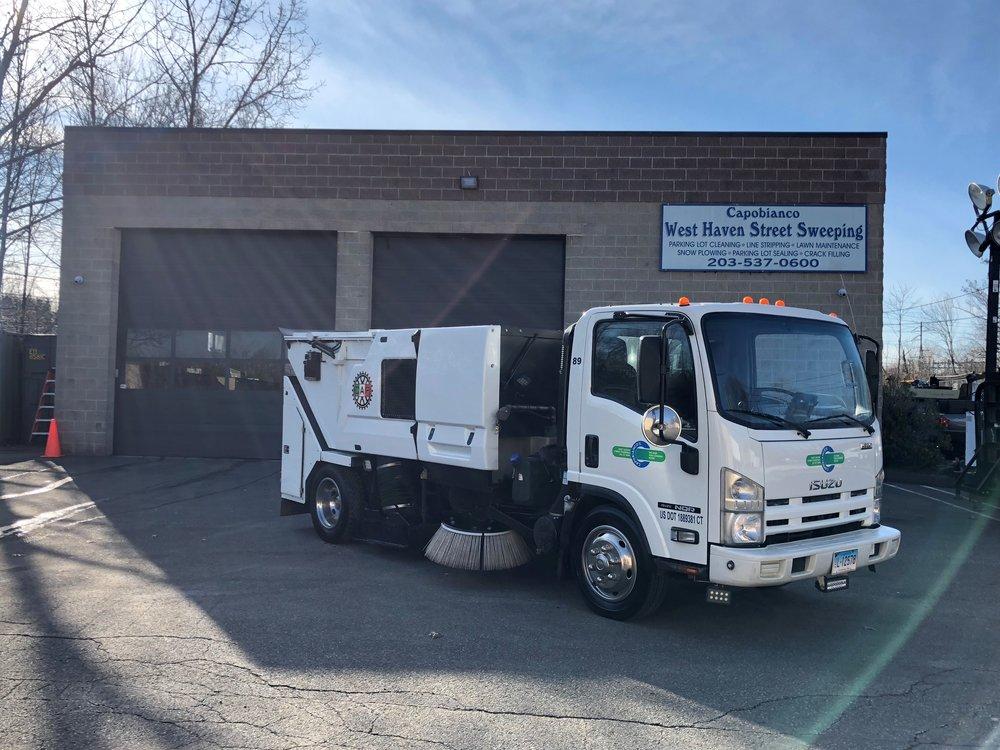 Updated Sweeper truck wiht new logos infront of garage 2.jpg