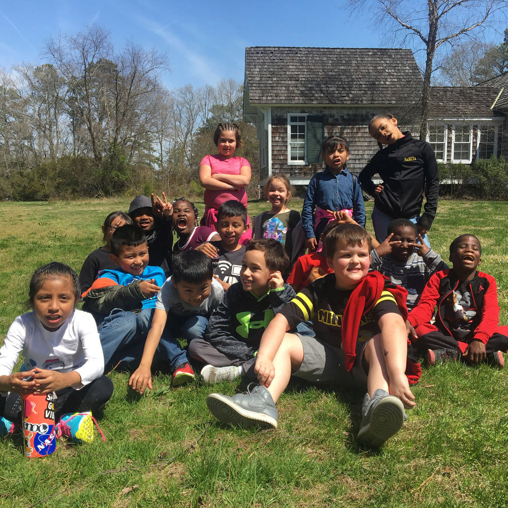 """Foster a Love for Nature - Each moment on the trail was a chance to learn. The students watched a turkey vulture glide above the trees. Lauren reflected later, """"On the vulture's back, the feathers are big, and on its stomach they are short. I learned that a turkey vulture can fly without its wings flapping."""""""