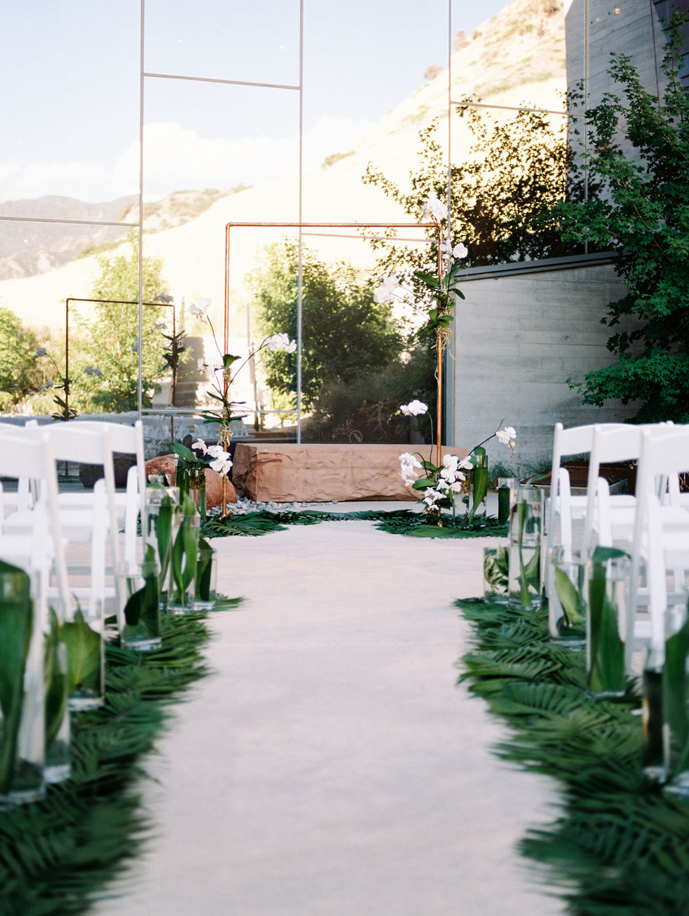 Wedding Isle Greenery Idea Copper and Orchid Florals