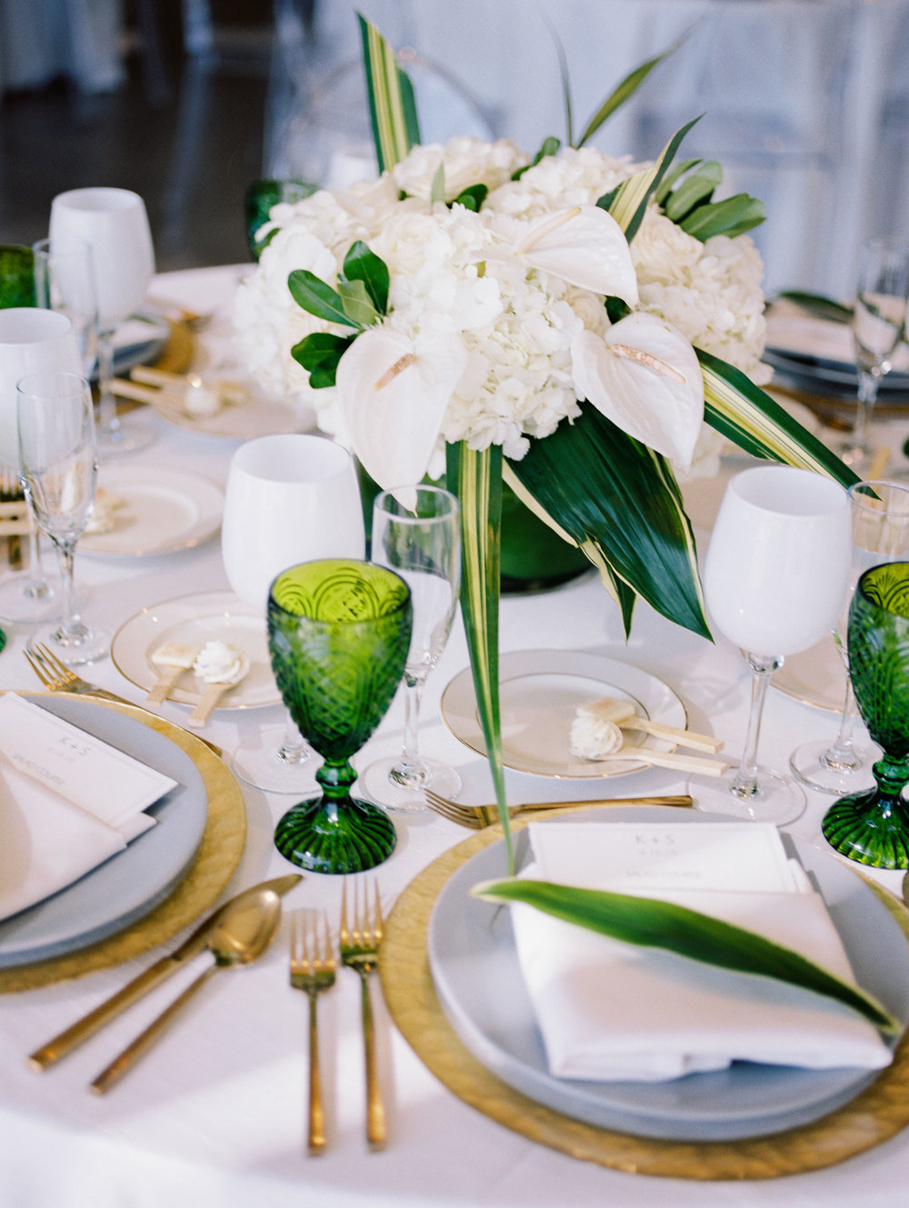 Gold white and green floral design for wedding table setting