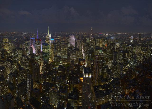 Above Manhattan, New York city skyline night buildings lights