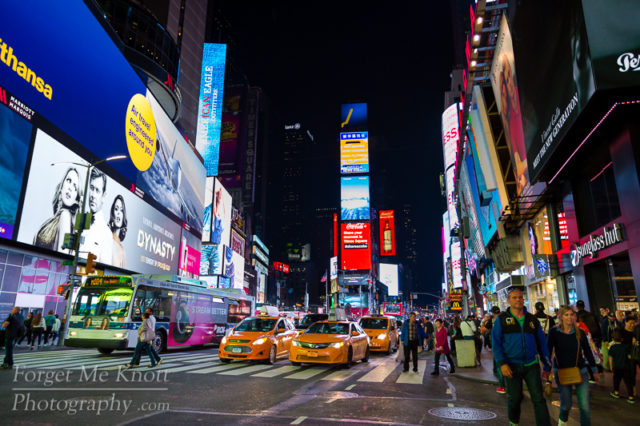 Times Square, New York city manhatten urban people taxis lights