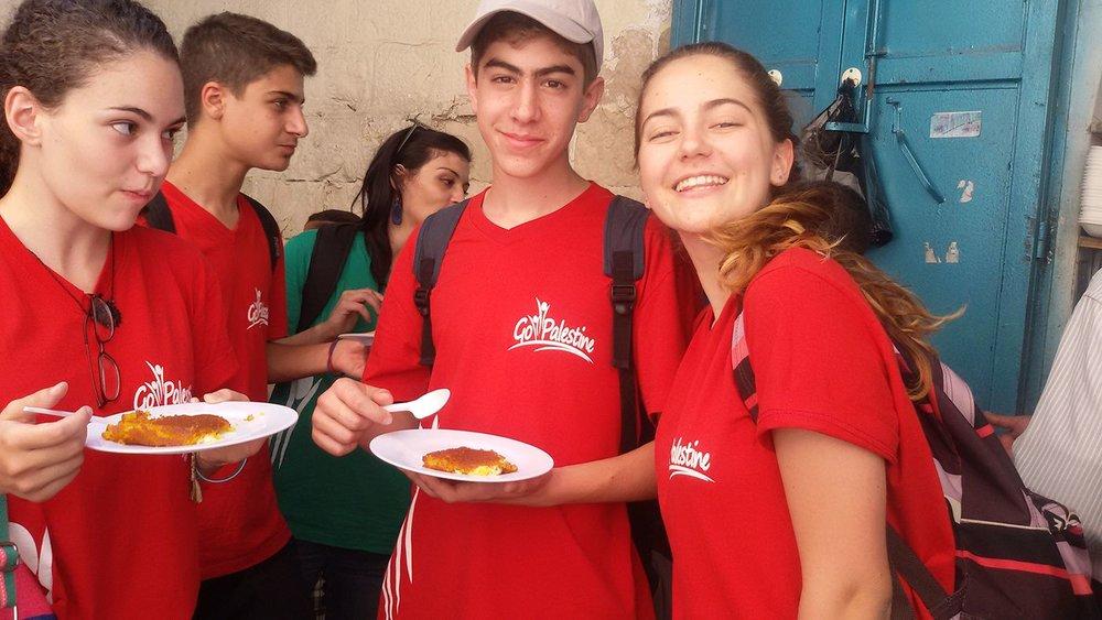Campers enjoying DELICIOUS knafeh in Nablus