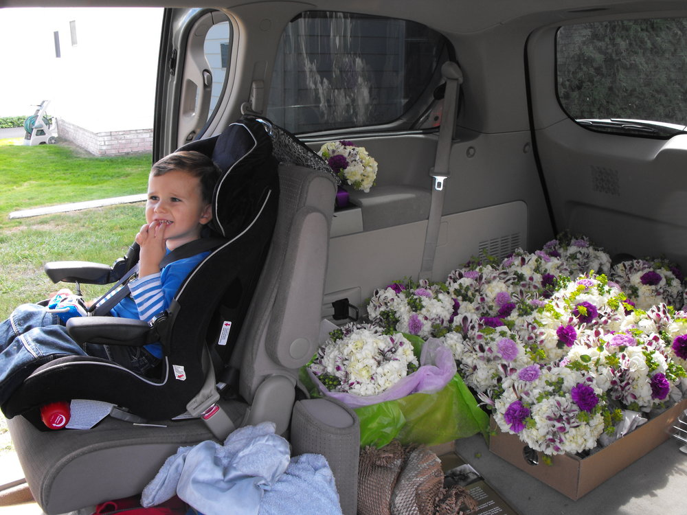 matty in car seat with flowers.JPG