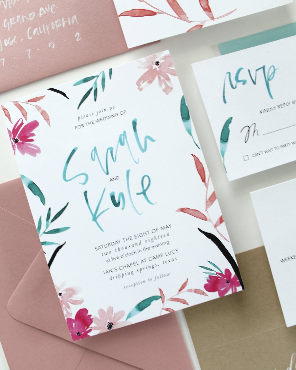 The Sarah Watercolor - This semi-custom brush calligraphy invitation features watercolor illustrations in bright colors and brush calligraphy lettering, it is definitely a suite that your guests will remember.