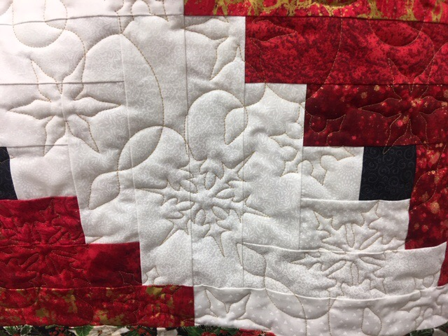 Snowflakes quilted on custom table runner.
