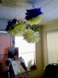 I have happy blue and yellow pom pom things hanging from the ceiling.