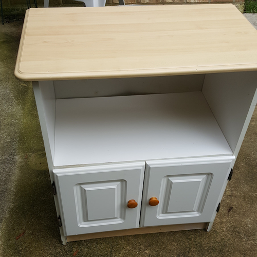 spray painting a cabinet