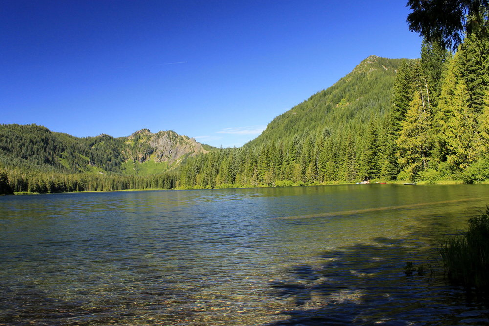 Elk Lake, backed by Mount Beachie and Battle Ax. Elk Lake is the starting point for several hikes. Getting to the lake is an adventure, but once you're there you won't want to leave.