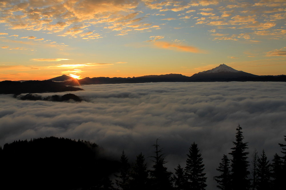Sunrise over Olallie Butte and a river of fog, as seen from Gold Butte Lookout.