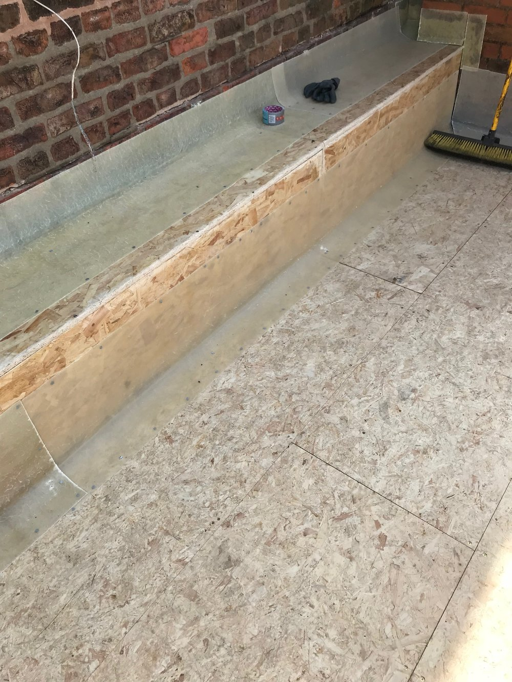 Problem solved! - Using OSB3 and concrete fixings, we boarded the entire parapet and used our own design and manufactured Edge Trims and Flashing system to create this junction.