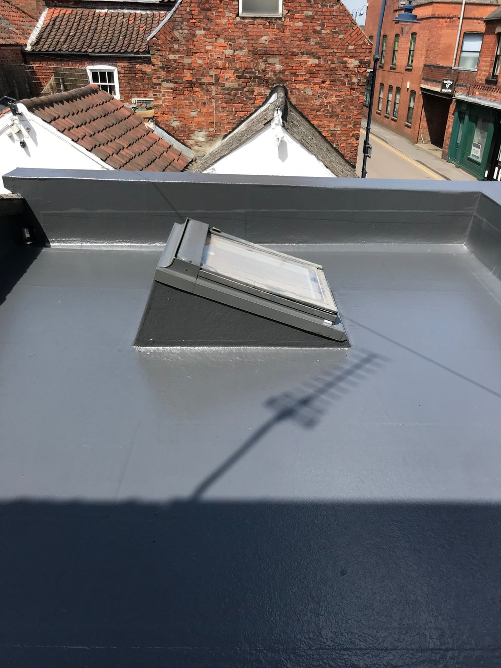 Only the best materials - Our fibreglass laminate system is created from 600gsm Fibreglass Matting, and Lloyd's approved Class2 Fire Retardant Resin which bonds perfectly to the edge trims and flashings. We then cover the Fibreglass Laminate with our high performance Flowcoat in our signature dark grey. Where every other roofing system has historically failed, ours excels.