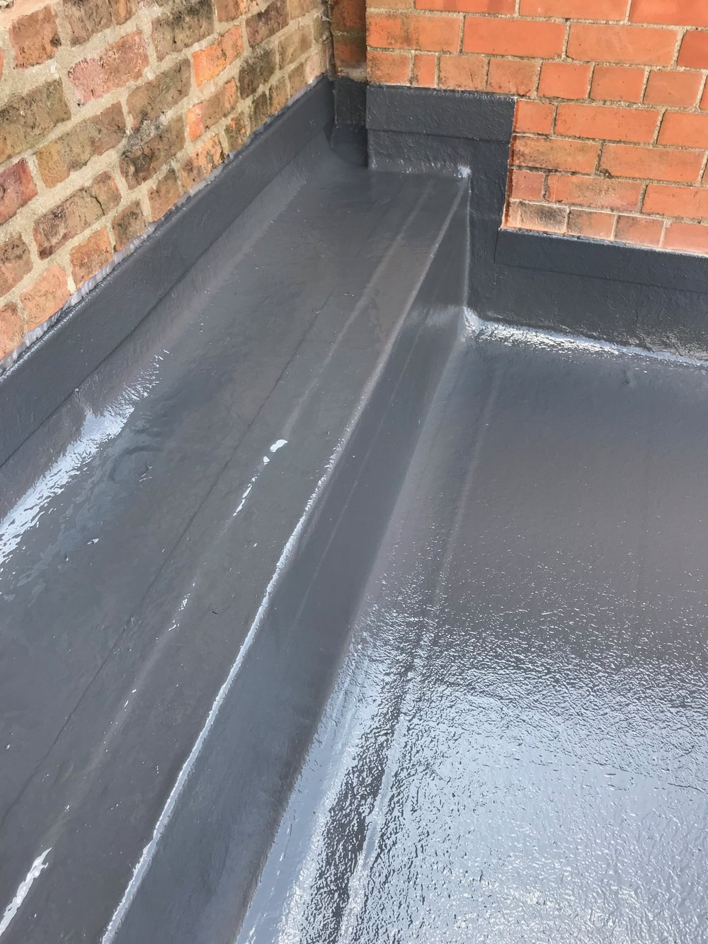 No more trouble - The Fibreworx system perfectly takes care of this troublesome parapet/wall area, which is now perfectly boxed in, laminated and sealed for life.