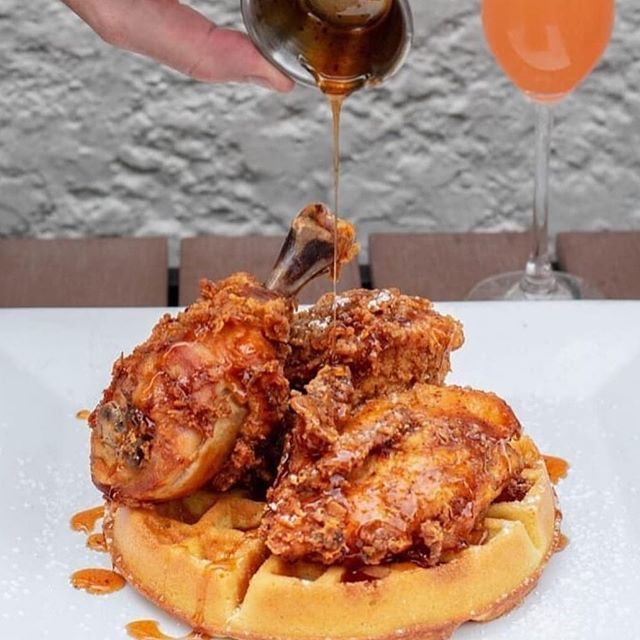 Fried chicken + warm syrup...is there a better combination?🤤 ⠀⠀⠀⠀⠀⠀⠀⠀⠀ You can find this dish this weekend @mwddenver! Tag your friend below and let them know you have mimosas & chicken and waffles to eat this weekend! 🤩 . . . 📸: @mwddenver