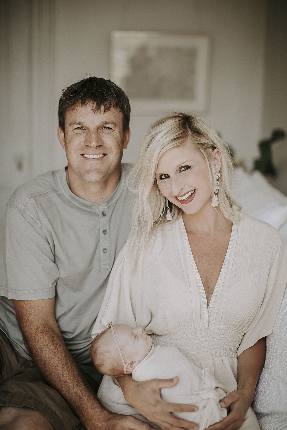 Mother and Father at Home with Newborn Baby Girl