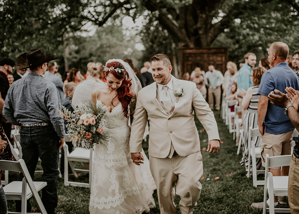 Bride and Groom Walking Down Aisle at Outdoor Wedding