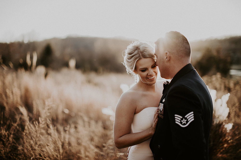 Bride and Military Groom Share a Romantic Moment in a Field