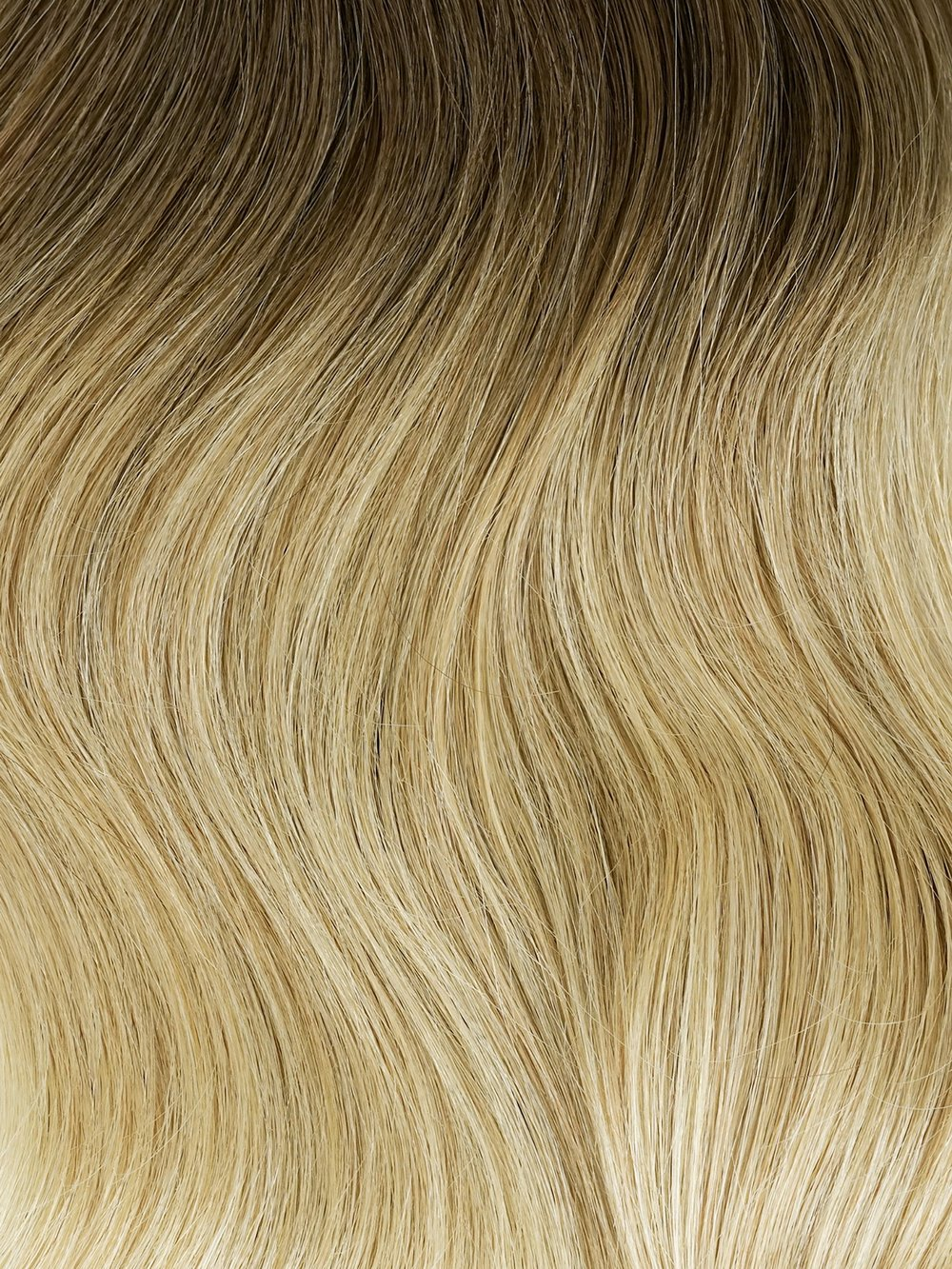 Champagne BALAYAGE #T6/184/16 - Using modern blending highlight techniques, this set has three transition points from a chestnut brown to a dimensional blonde seamlessly blending into a warm platinum blonde.