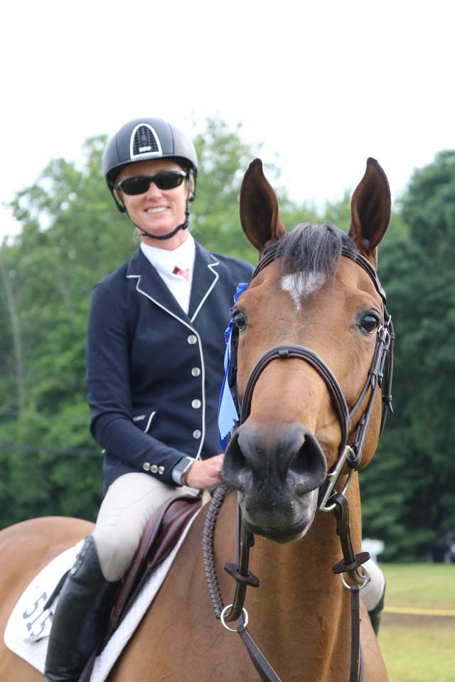 KIM MULLIGAN-MANGIONE - What began as a love of horses, has turned into a life-long passion. In the saddle, Kim is a fierce competitor, focusing primarily on jumpers, including at the Grand Prix Level. When she's not riding, she is helping clients of all ages and ability to realize their true potential.Twin Bays Stable has successfully trained riders in the hunter/ jumper and equitation rings — from short stirrup to Grand Prix. While Kim's students have earned top honors in highly competitive show arenas (regional/ zone/ national finals), she is always happy to work with anyone who willing to learn. Her ultimate goal is to have each of her students become safe, courteous riders with a lifelong love for horses.Twin Bays Stable is named after her first two horses, Ruby and What, both dark bays. Even now, many of the horses in the barn are bays, of course, with a few exceptions! Kim keeps her retired horses close to home so she's never too far away for a treat and a pat.