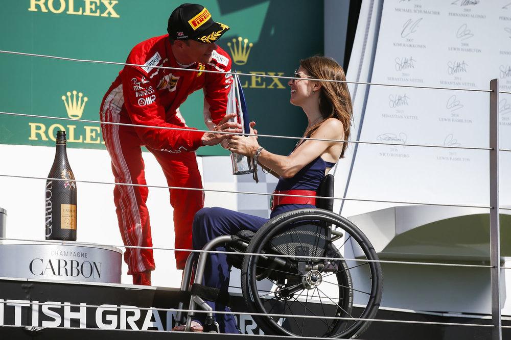 Nathalie_McGloin_Ambassador_Handing_Kimi_the_trophy.jpg