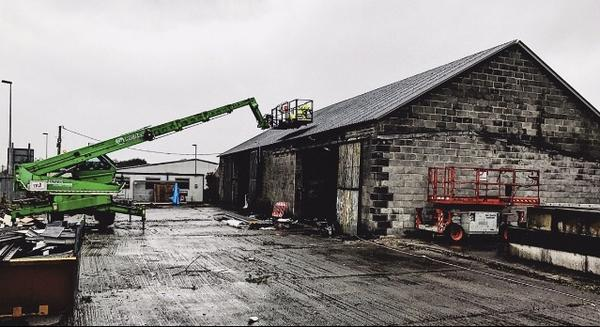After saving diligently and waiting for the right space to set up their roastery. - The Coal Town team paired up with TRJ team to look for a site for our new roastery in the Ammanford area. Dafydd Jones, one of the directors of TRJ suggested the old workshops opposite their site. This was the location Scott had been searching for.