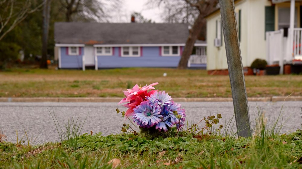 Flowers where Rhonda Jones was found in a trash can just across the street from the house where Kristin Bennett was found dead. (Photo by Russ Bowen)