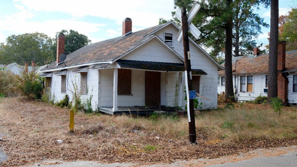 Megan Oxendine was found dead under some brush and shingles in the backyard of this house. (Photo by Russ Bowen)