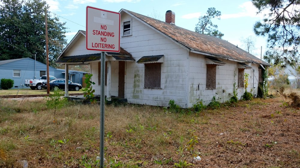 Megan Oxendine was found underneath brush and shingles outside this home. (Photo by Russ Bowen)