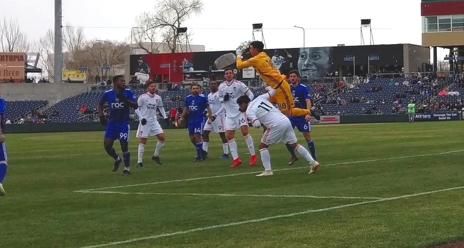 Reno 1968's JT Marcinkowski skies over Orange County SC's Harry Forrester