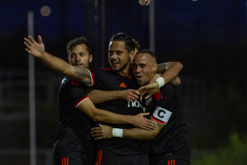 Orange County SC's Harry Forrester celebrates with teammates after Kevin Alston's goal against Tulsa Roughnecks FC | Photo courtesy of Orange County SC