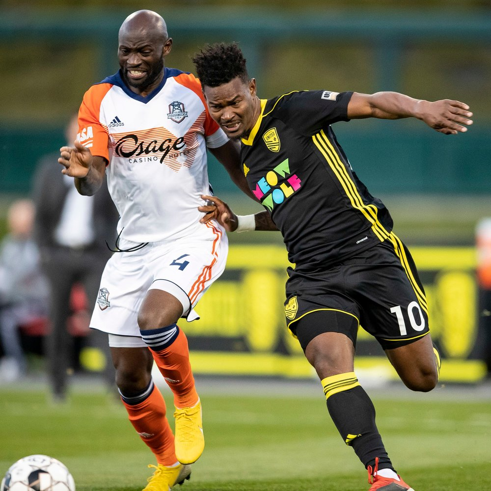 New Mexico United's Kevaughn Frater battles with Tulsa Roughneck FC's Cyprian Hedrick | Photo courtesy of New Mexico United