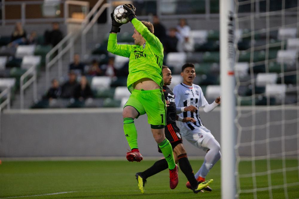 Orange County SC goal keeper Patrick McLain makes a save against Colorado Springs Switchbacks FC  |  Photo courtesy of Orange County SC