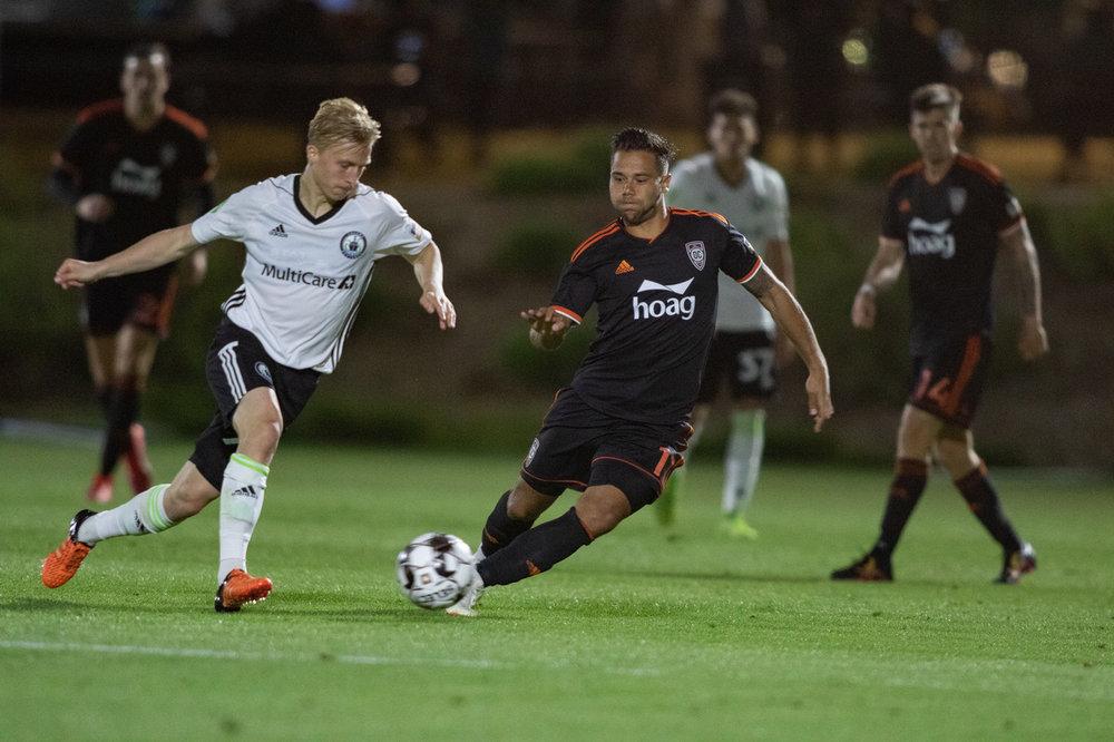 Orange County SC's Harry Forrester chases down Tacoma Defiance midfielder Joel Rydstrand | Photo courtesy of Orange County SC