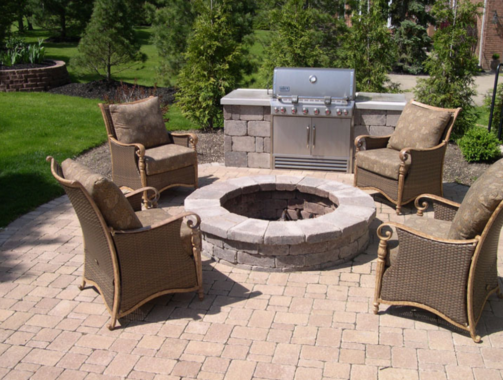 Landscape design with brick patio, outdoor fireplace and outdoor kitchen in Chagrin Falls, Ohio